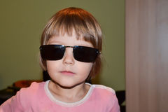 11e8bb1f4f7 Little girl with oversized sunglasses. stock photography
