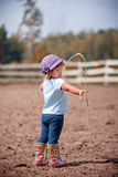 Little girl in paddock Royalty Free Stock Image