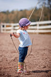 Little girl in paddock Stock Image
