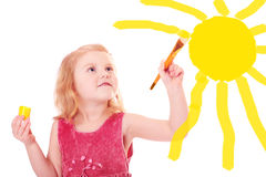 Little girl with paint Stock Images