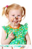 Little girl in paint Stock Images