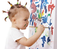 Little girl paint on a board Royalty Free Stock Photos