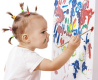 Little girl paint on a board Royalty Free Stock Photo