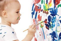 Little girl paint on a board Royalty Free Stock Image