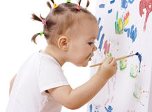 Little girl paint on a board stock photography
