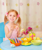 Little girl paint Easter eggs Royalty Free Stock Photography
