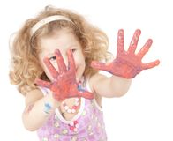 Little girl with paint hands isolated on white Stock Images