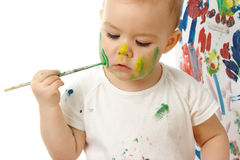 Little girl paint on her cheek Stock Photography