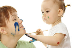 Little girl paint on her mother Royalty Free Stock Images