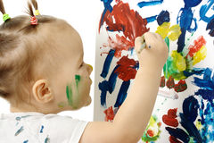Little girl paint on a white board Stock Photo