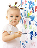 Little girl paint on a white board Stock Photos