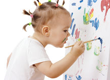 Little girl paint on a white board Royalty Free Stock Image