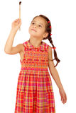 Little girl with a paintbrush, front view Stock Images