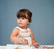Little girl with paintbrush in her hand Stock Images