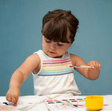 Little girl with paintbrush in her hand Stock Photography
