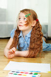 Little girl with paintbrush. L little girl with paintbrush on a floor Royalty Free Stock Images