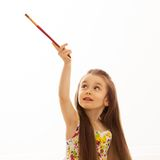 Little girl with a paintbrush on white background Stock Photos