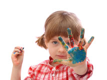 Little girl with with painted hand. Hand is in focus Royalty Free Stock Photography