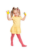Little girl with painted hands Stock Photos