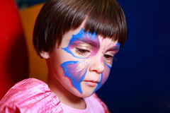 Little girl painted for holiday Royalty Free Stock Image