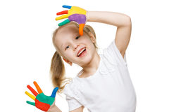 Little girl with painted palms. Closeup of little girl with painted palms over white background royalty free stock image
