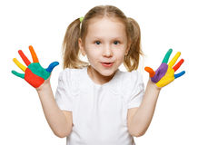 Little girl with painted palms Royalty Free Stock Images