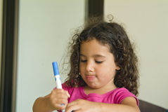 Little girl painting Stock Images