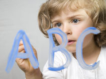 Little girl painting alphabet Stock Photography