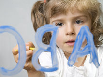 Little girl painting alphabet Stock Photos