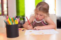 Little girl is painting Stock Photography