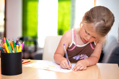 Little girl is painting Royalty Free Stock Images