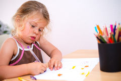 Little girl is painting Stock Photo