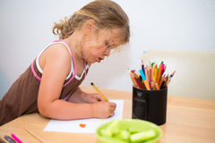 Little girl painting with colored pencil Stock Photography