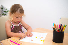 Little girl  painting with colored pencil Royalty Free Stock Photography