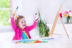Little girl painting Stock Photos