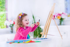Little girl painting royalty free stock image