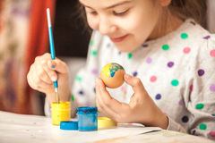 Little girl painting easter egg Royalty Free Stock Photos
