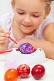 Little girl painting easter egg Royalty Free Stock Image