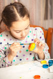 Little girl painting easter egg with watercolor Royalty Free Stock Photos