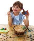 little girl painting easter eggs Stock Photos