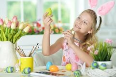 Girl  painting eggs. Little girl painting eggs for Easter holiday Royalty Free Stock Photo