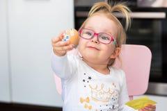 Little girl painting eggs for Easter. Morning Royalty Free Stock Photo