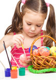 Little girl is painting eggs preparing for Easter Stock Photos