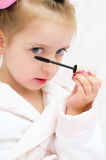 Little girl painting eyes Royalty Free Stock Images