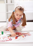 Little girl painting with finger Royalty Free Stock Image