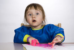 Little girl painting finger paint Stock Images