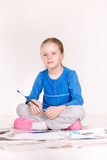 Little Girl Painting on the Floor Royalty Free Stock Photos