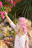 Little girl painting a flower Royalty Free Stock Images