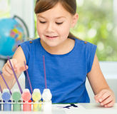 Little girl is painting with gouache Royalty Free Stock Image