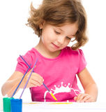 Little girl is painting with gouache Stock Photos